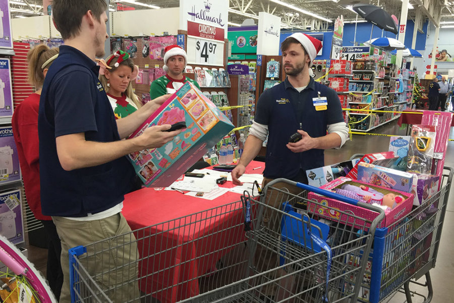 Joy of Giving Volunteers Helping with Presents | The Joy of Giving supports families in need in Collier County