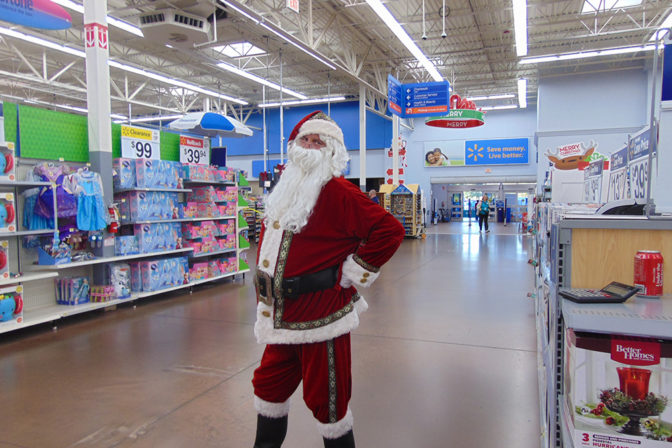 Santa Claus Posing at the Joy of Giving Event | The Joy of Giving supports families in need in Collier County