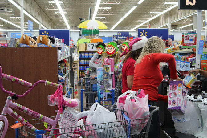 Cart full of Presents and Volunteers | The Joy of Giving supports families in need in Collier County