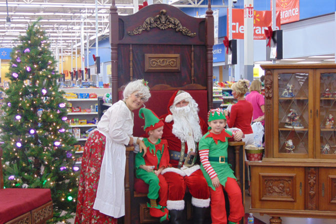 Santa and Mrs. Claus with their Elves | The Joy of Giving supports families in need in Collier County