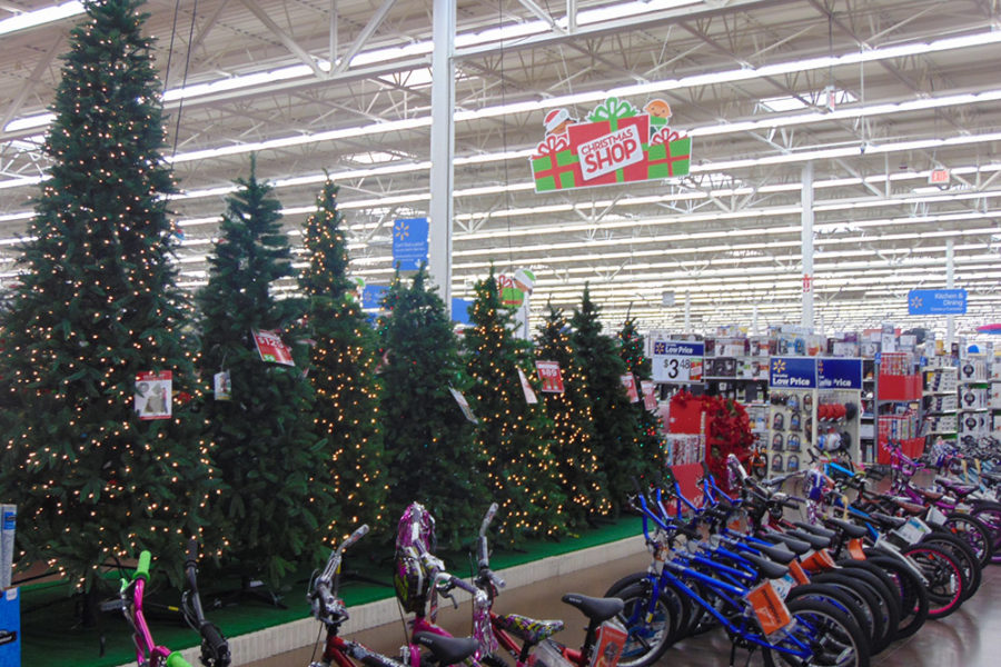Row of Children's Bikes in Front of a row of Christmas Trees | The Joy of Giving supports families in need in Collier County