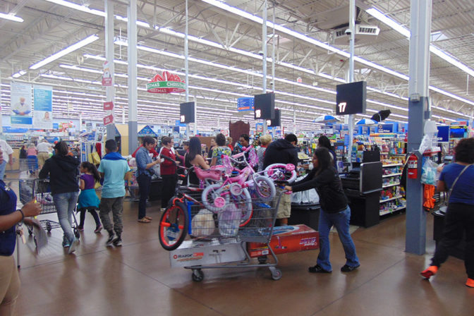 Carts overfilled with toys at the Joy of Giving Event | The Joy of Giving supports families in need in Collier County