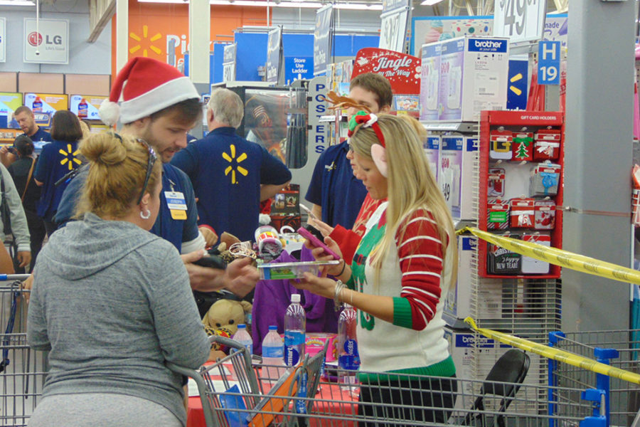 Joy of Giving Volunteers Helping Parents Choose Toys | The Joy of Giving supports families in need in Collier County
