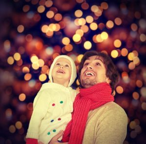 Dad and Daughter at Christmas | The Joy of Giving supports families in need in Collier County